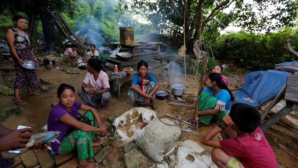 Ethnic Rakhine people who fled from Maungdaw after Arakan Rohingya Salvation Army (ARSA) had attacked, cook their meal at Buthidaung, Myanmar on 28 August 2017