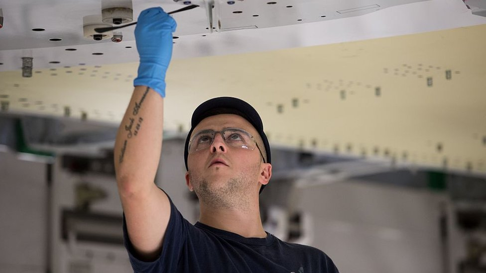 An Airbus employee constructs a wing for an Airbus A350 aircraft at Airbus' wing production plant near Broughton in north-east Wales