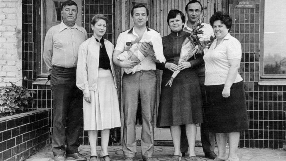 Sergei Skripal holding Yulia at the time of her birth with family members