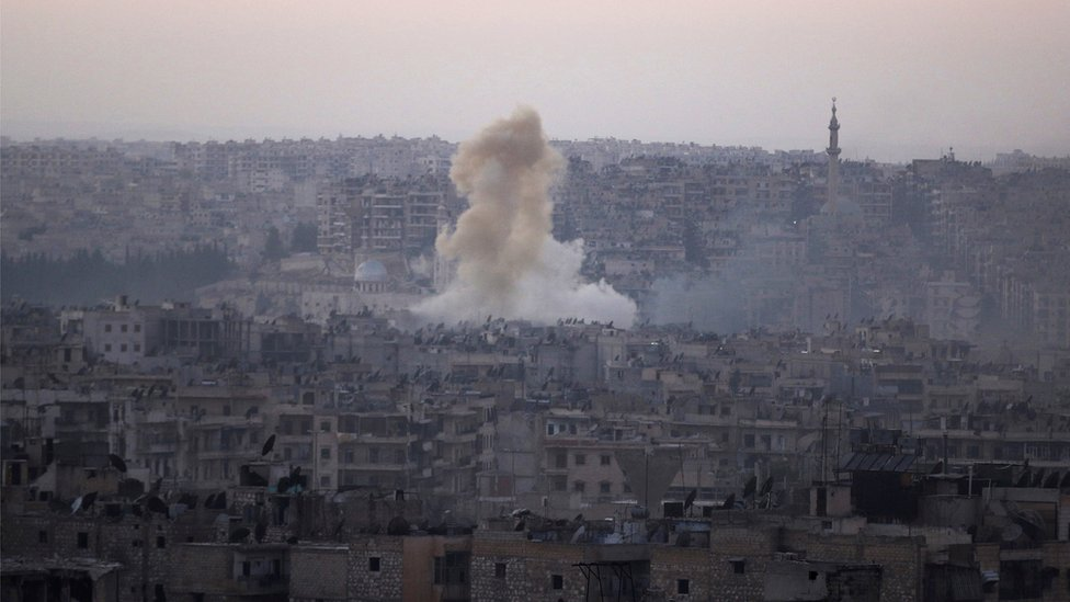 Smoke rises from Bustan al-Basha neighborhood of Aleppo