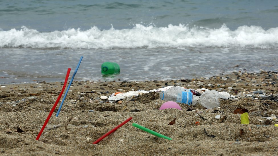 Plastic rubbish lies on the Aegean sea beach near Athens