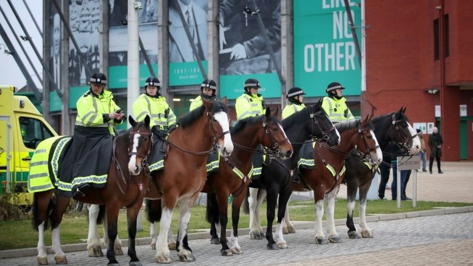 Police officers and horses at Celtic Park