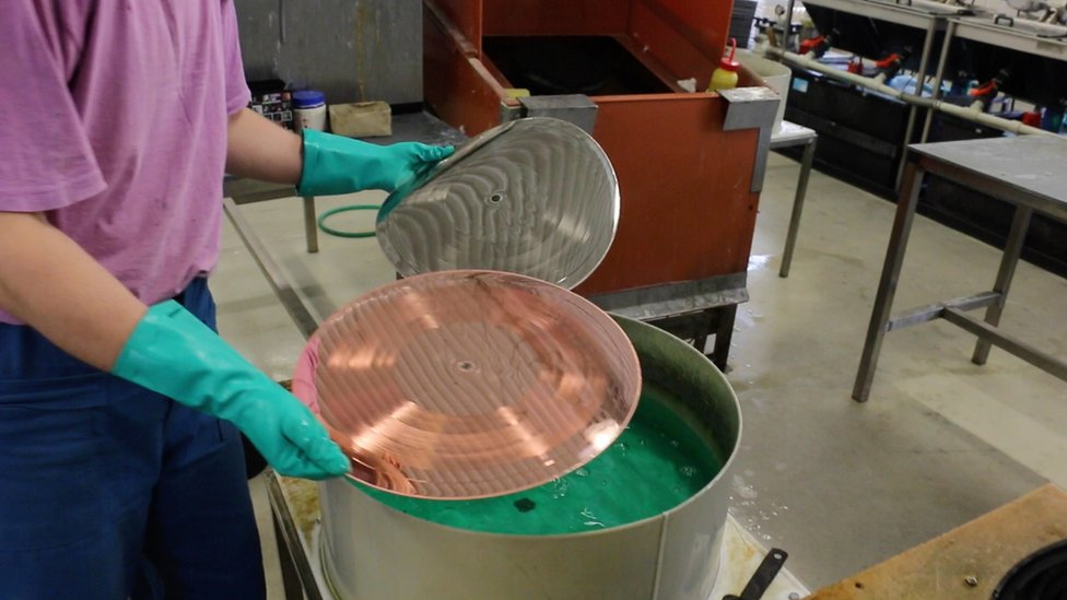 A layer of nickel forms on the copper plate to create the stamper