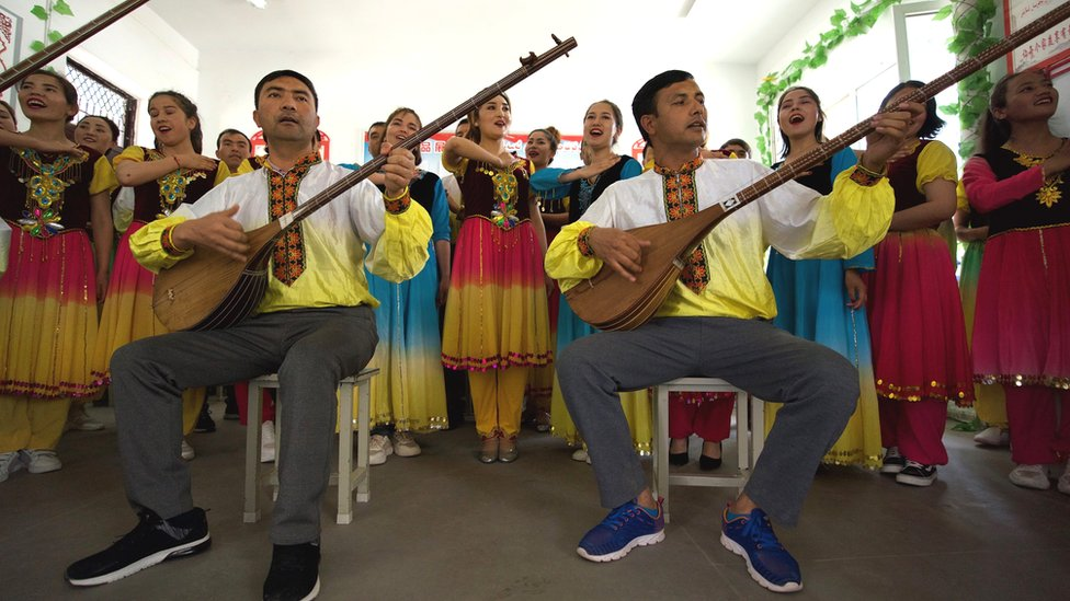 Uighurs singing in a classroom