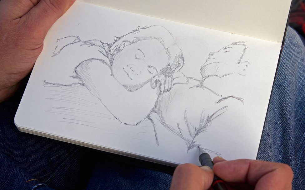 Stephen O'Grady sketching in his pad