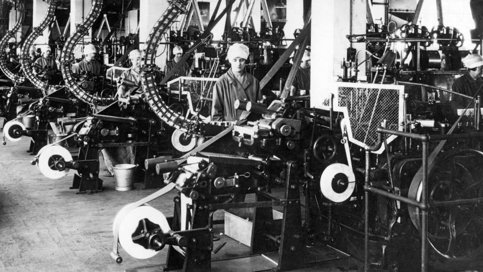 Woman at an assembly line in a UK factory in the 1920s