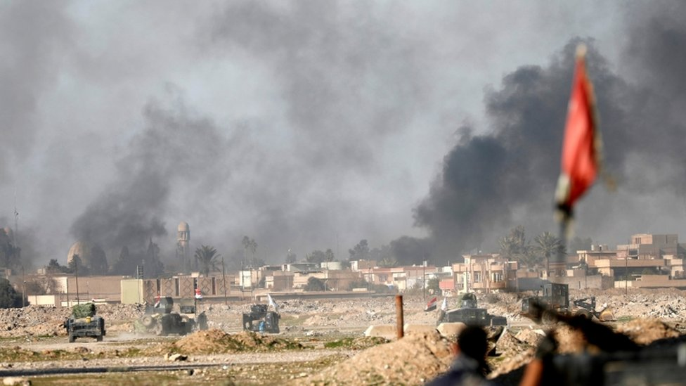 Iraqi forces press on towards western districts