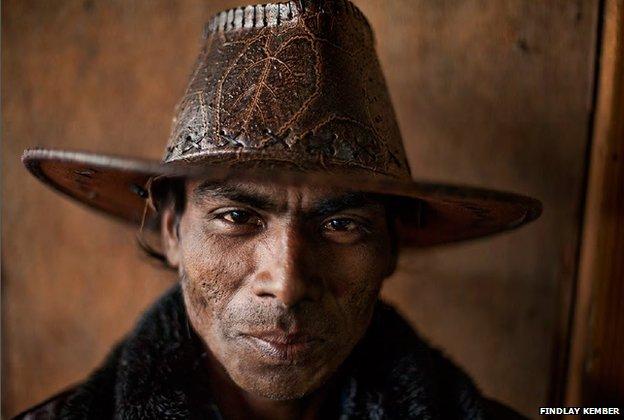 Portrait of a man in a tea shop in Tanai, Myanmar