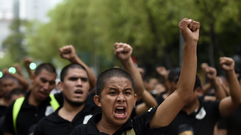 Students and activists take part in a demonstration to mark the fourth anniversary of the disappearance of 43 students of the teaching training school in Ayotzinapa, in Mexico City, on September 26, 2018.