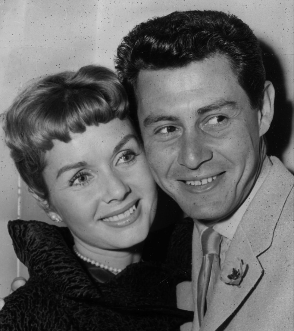 4th June 1957: American singing star Eddie Fisher and his wife, film star Debbie Reynolds at a press reception. Eddie Fisher is to appear at the London Palladium in mid-June.