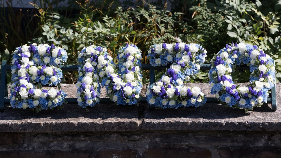 Blue and white flowers spelling out Enzo at the funeral of Enzo Calzaghe in Newbridge