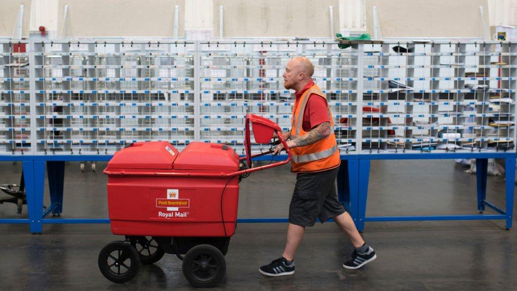 Royal Mail profits more than halve