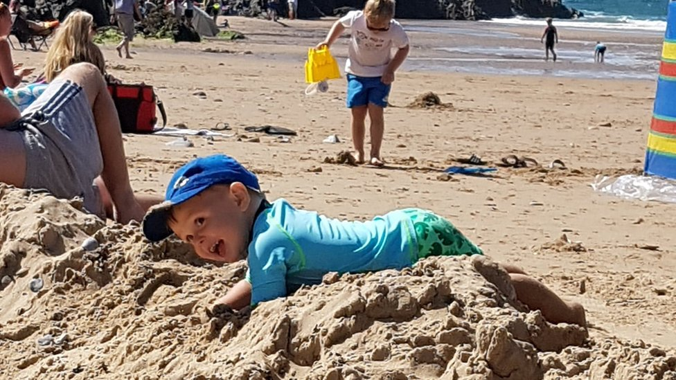 Harri, 2, playing in the sand
