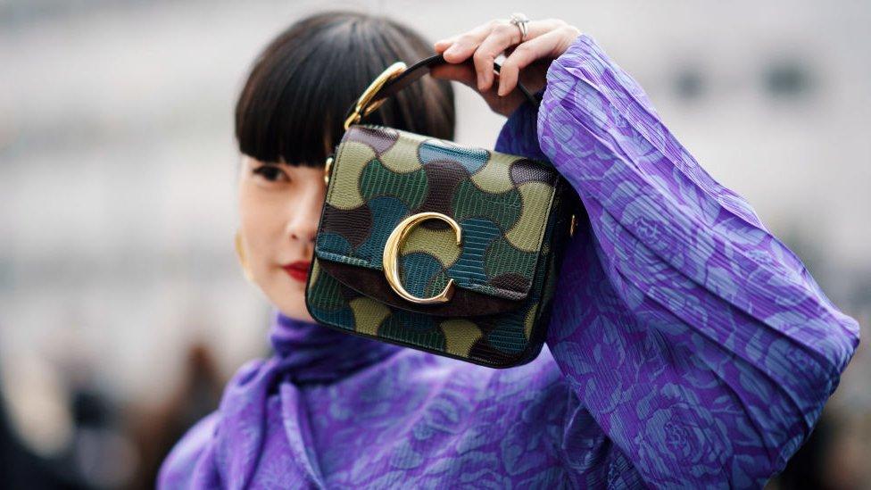 Model holding Chloe handbag