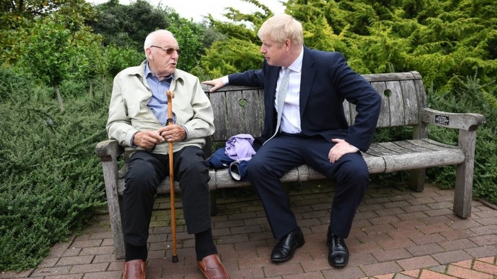 Boris Johnson speaking to a pensioner at Wisley