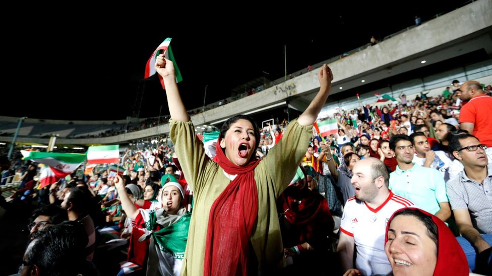 An Iranian woman cheers while watching the World Cup Group B soccer match between Portugal and Iran at Azadi stadium in Tehran on June 25, 2018.