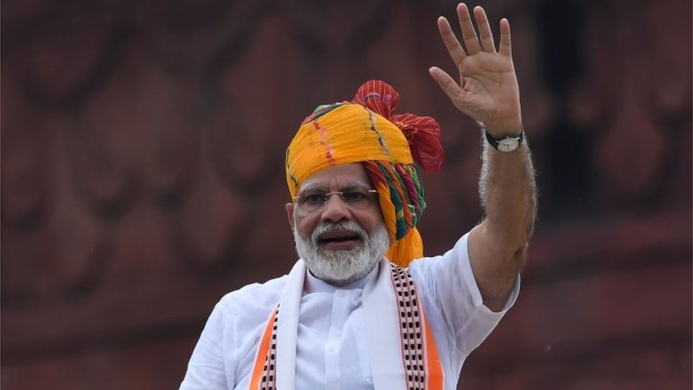 India's Prime Minister Narendra Modi waves at the crowd during a ceremony to celebrate country's 73rd Independence Day, which marks the of the end of British colonial rule, at the Red Fort in New Delhi on August 15, 2019.