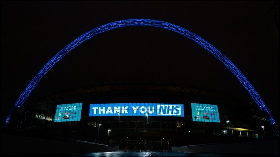 Wembley Stadium Arch in London lit up in blue