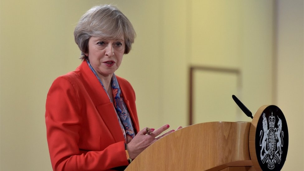 Theresa May gives a press conference in Brussels