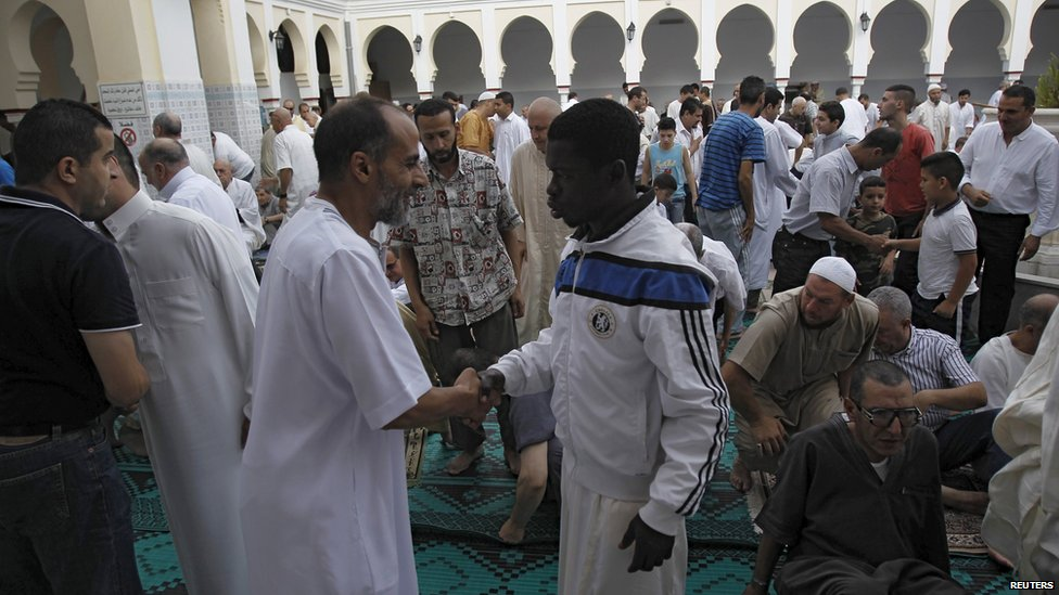 Worshippers congratulate each other after morning prayers of Eid al-Fitr holiday, marking the end of the holy month of Ramadan, at al-Biar mosque in Algiers, Algeria on Friday