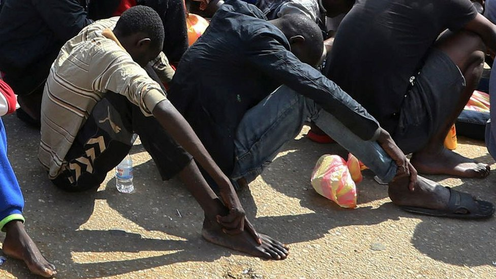 African migrants gather at the Tripoli branch of the Anti-Illegal Immigration Authority, in the Libyan capital, 23 March 2017
