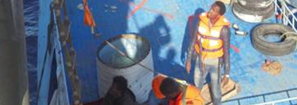 Rescued migrants are taken off the boat