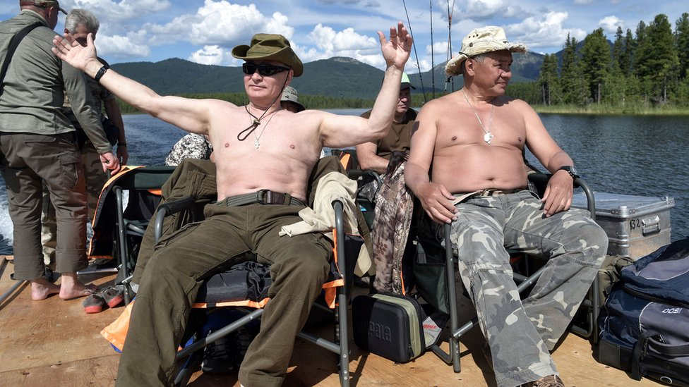 President Putin and defence minister defence minister Sergei Shoigu - both topless