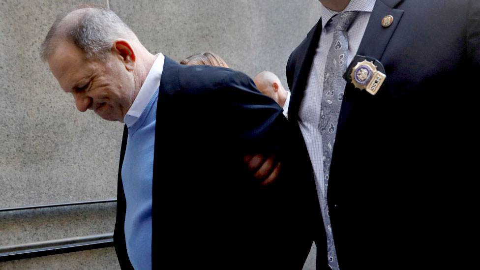 Weinstein in handcuffs