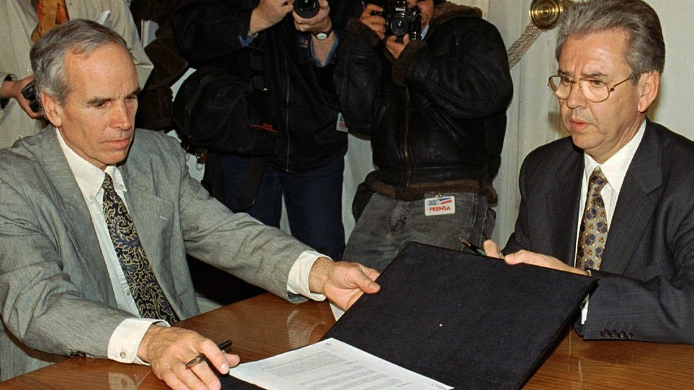 In this July 7, 1997, file photo, American millionaire Douglas Tompkins, left, and Juan Villarzu, chief of staff of the Chilean president, hold the text of an accord signed in Santiago, Chile.