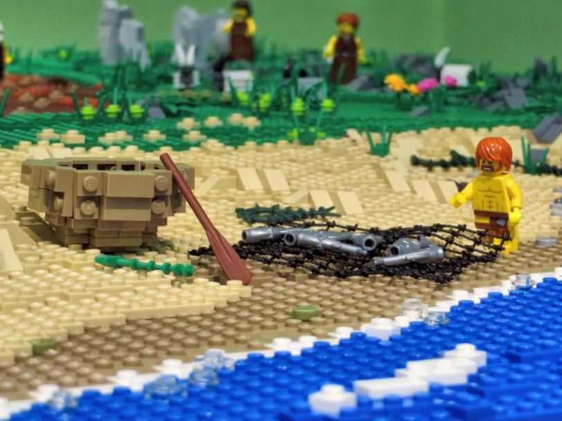 Lego mini figure and coracle