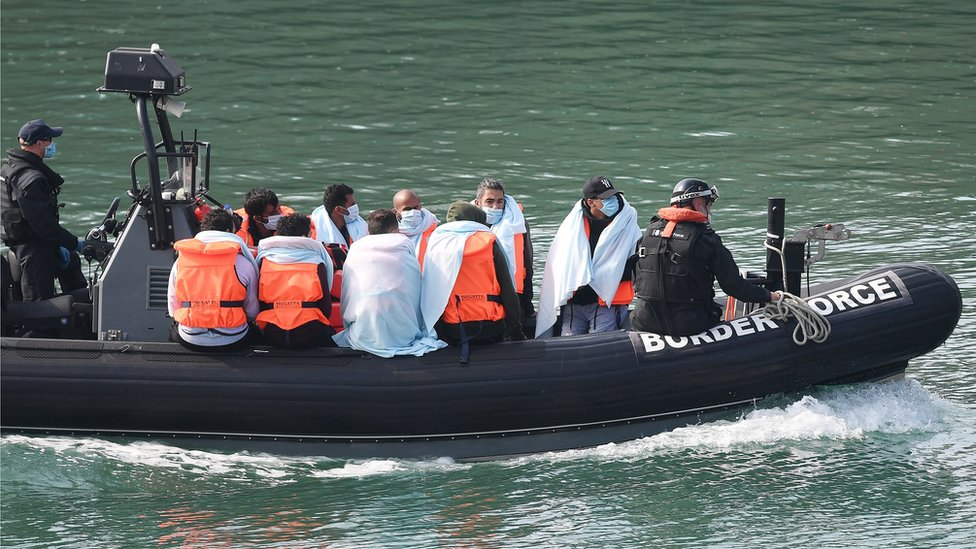 Migrants on a Boarder Force boat