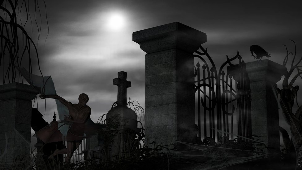Kladbiщenskaя ograda i temnaя figura