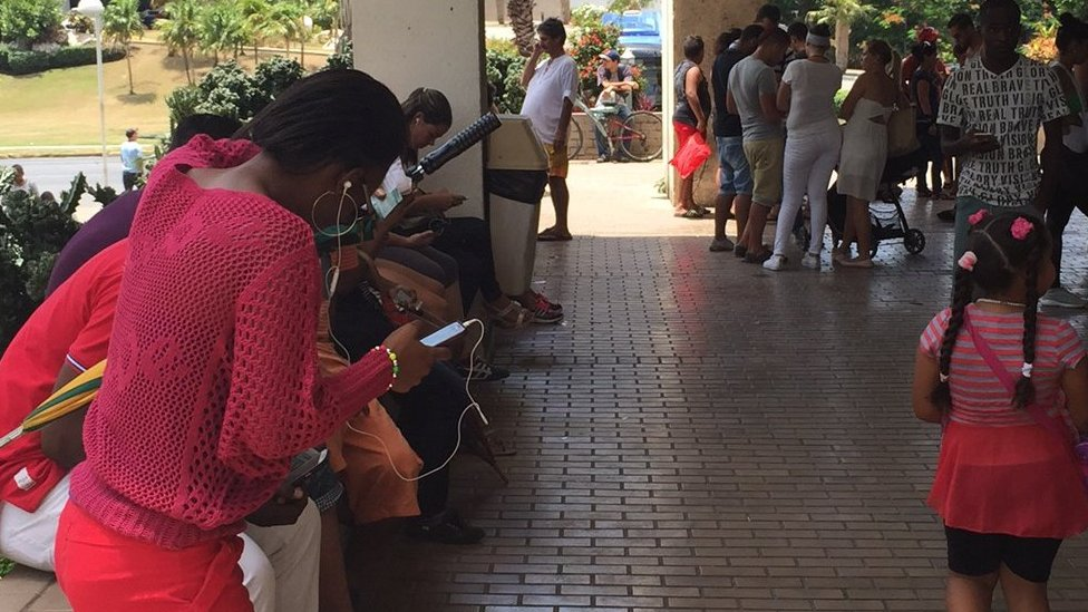 Cuban use one of the wi-fi hotspots to go online. File photo