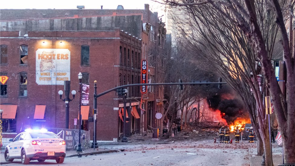 Debris litters the road near the site of an explosion in the area of Second and Commerce in Nashville