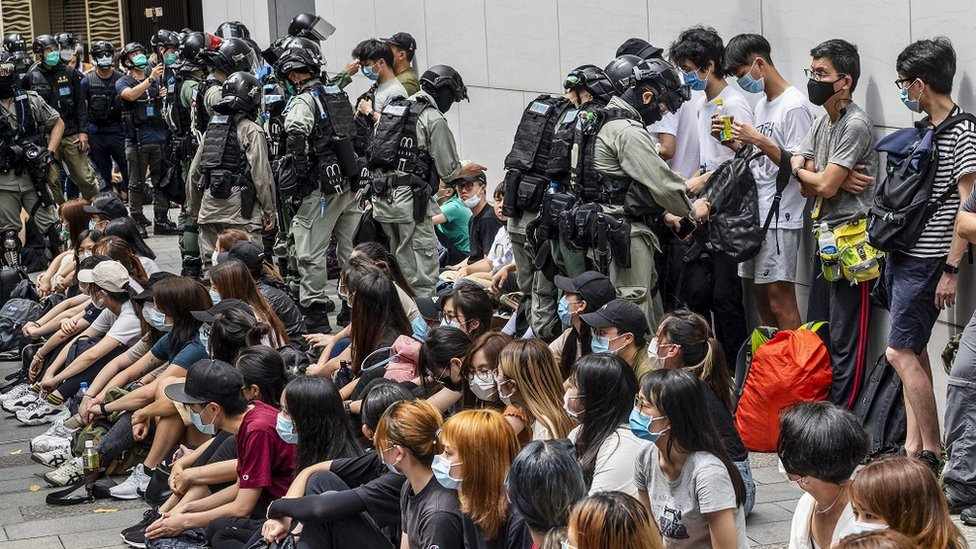 "Police officers opening detainees"" bags and checking on their smartphones as police has set up a police cordon around the area in Causeway Bay, Hong Kong, China, 27 May 2020. The Second Reading debate on the National Anthem Bill is set to resume at the Legislative Council on 27 May amid growing anger at Beijing""s plan to impose a national security law on the city banning sedition, secession and subversion through a method that could bypass Hong Kong""s legislature."