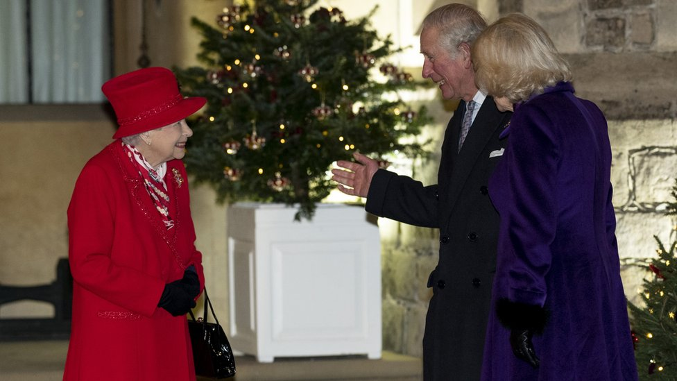 The Queen speaks to Prince Charles and Camilla