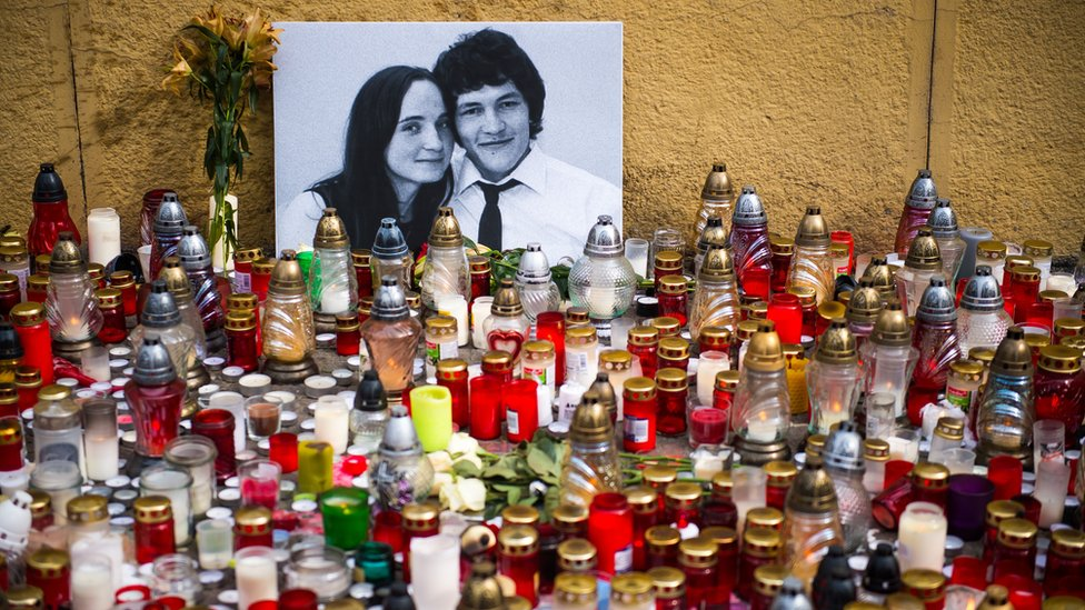 Hundreds of candles have been placed in front of a portrait of Slovak investigative journalist Jan Kuciak and his girlfriend Martina Kusnirova