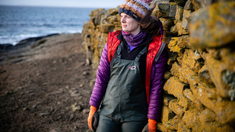 Sian Tarrant in front of stone wall
