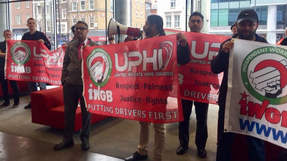 Uber couriers and drivers occupying the firm's London offices