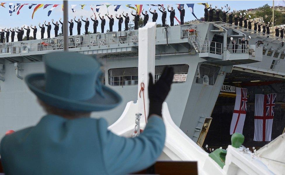 The Queen waves British Royal Navy crew members on HMS Bulwark in Valletta, Malta