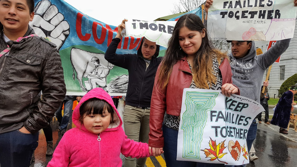 Alex Carrillo (left) with daughter and wife, leading a 2016 march to free Victor Diaz. Days later, Victor was released due to public pressure.