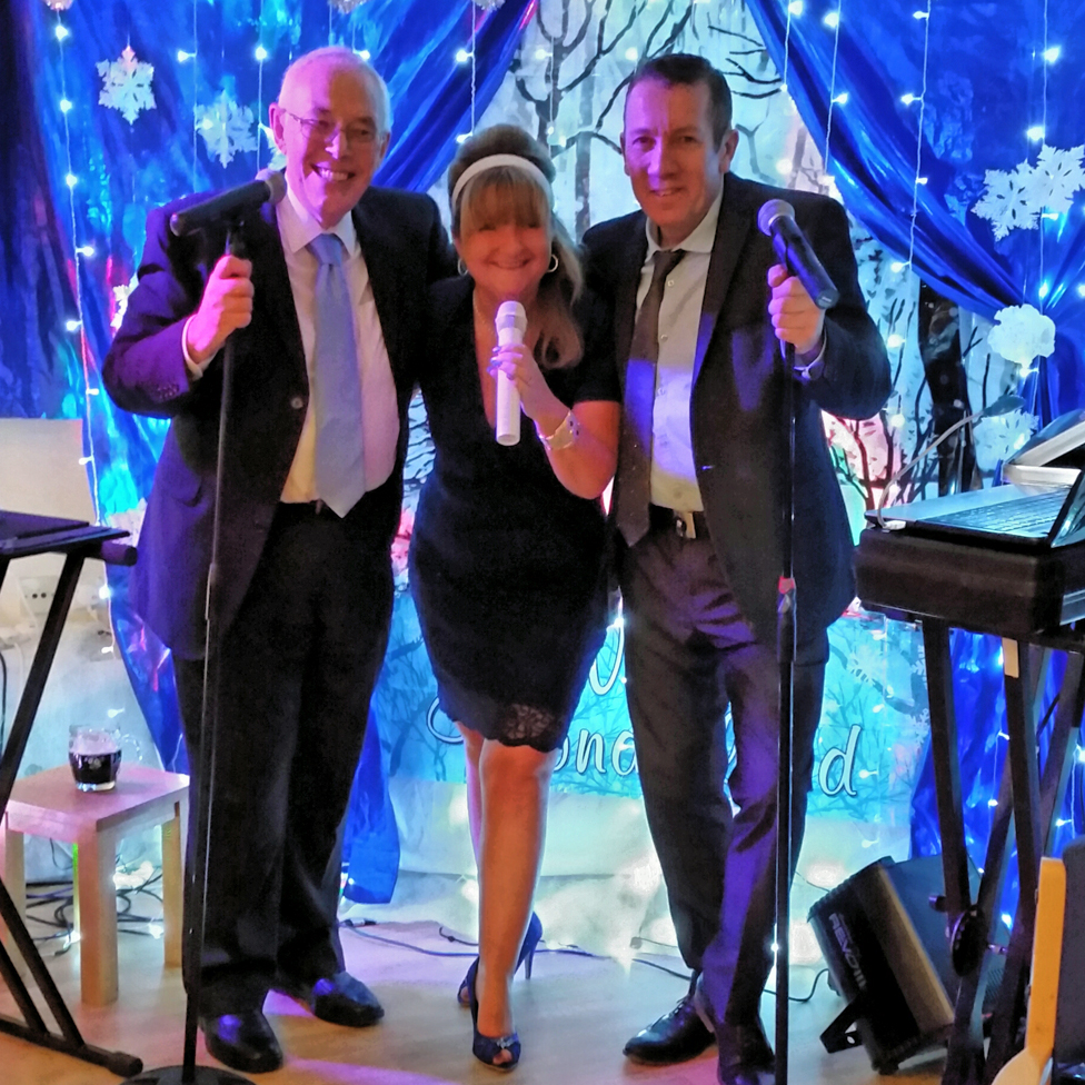 The reverend Walford, Rachel Burns and Roy Matthews, a professional singer, at a music night