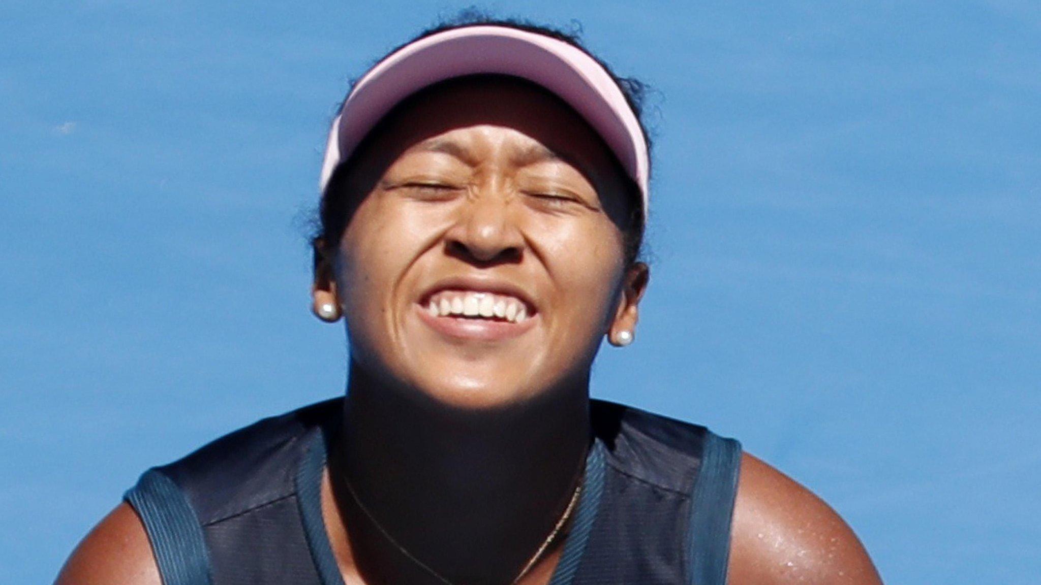 Osaka fights back to reach Australian Open quarters