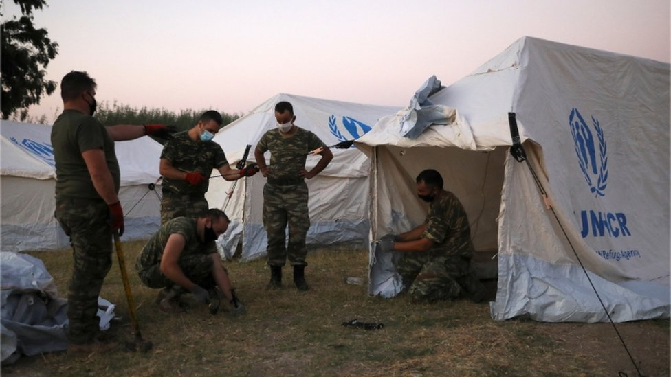 Soldiers set up tents on Moriya