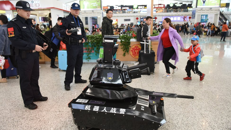 A police robot tank patrols the waiting hall on the first day of the Spring Festival travel rush at the Shenzhen North Railway Station on January 21, 2019 in Shenzhen, Guangdong Province of China.