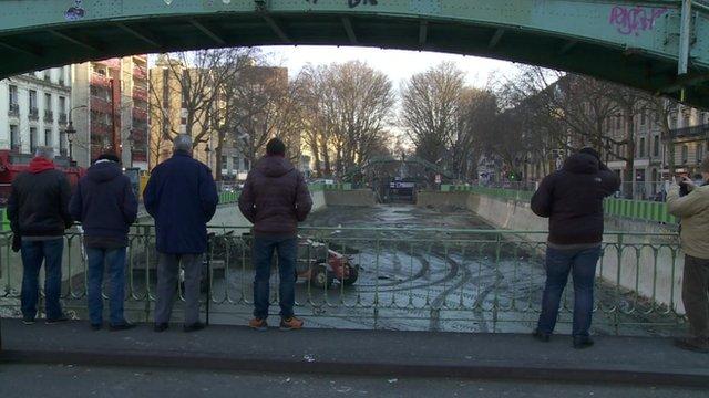 A crowd gathers at Canal Saint Martin