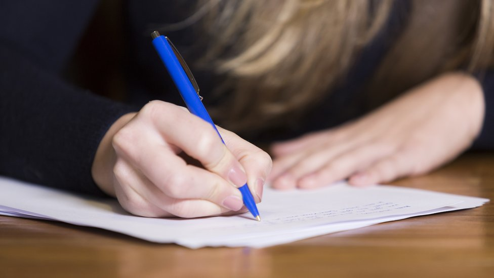Photo of girl doing an exam paper