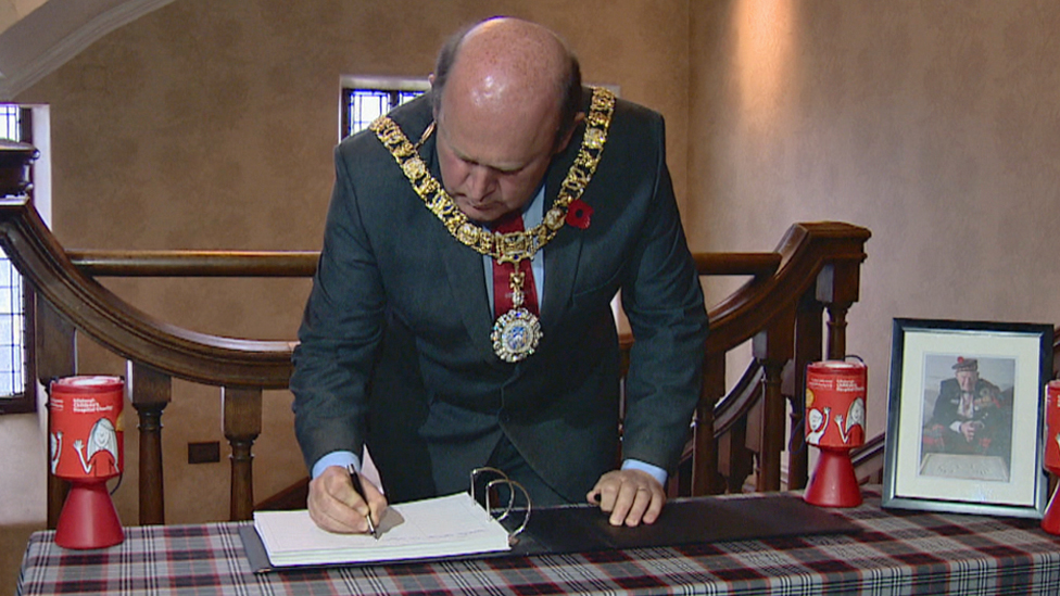 Lord Provost Frank Ross signs the book of condolence