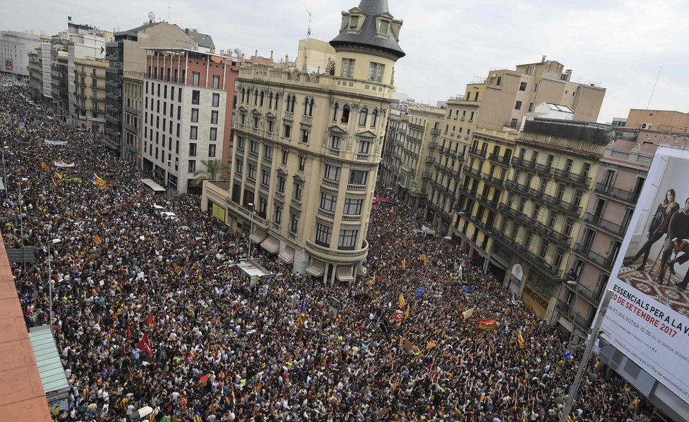 Protesters gather at the Placa de la Universitat square in Barcelona on 3 October