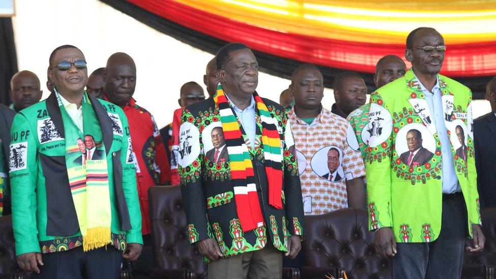 Zimbabwean President Emmerson Mnangagwa (C) before addressing thousands of supporters who had gathered at White City Stadium in Bulawayo, Zimbabwe